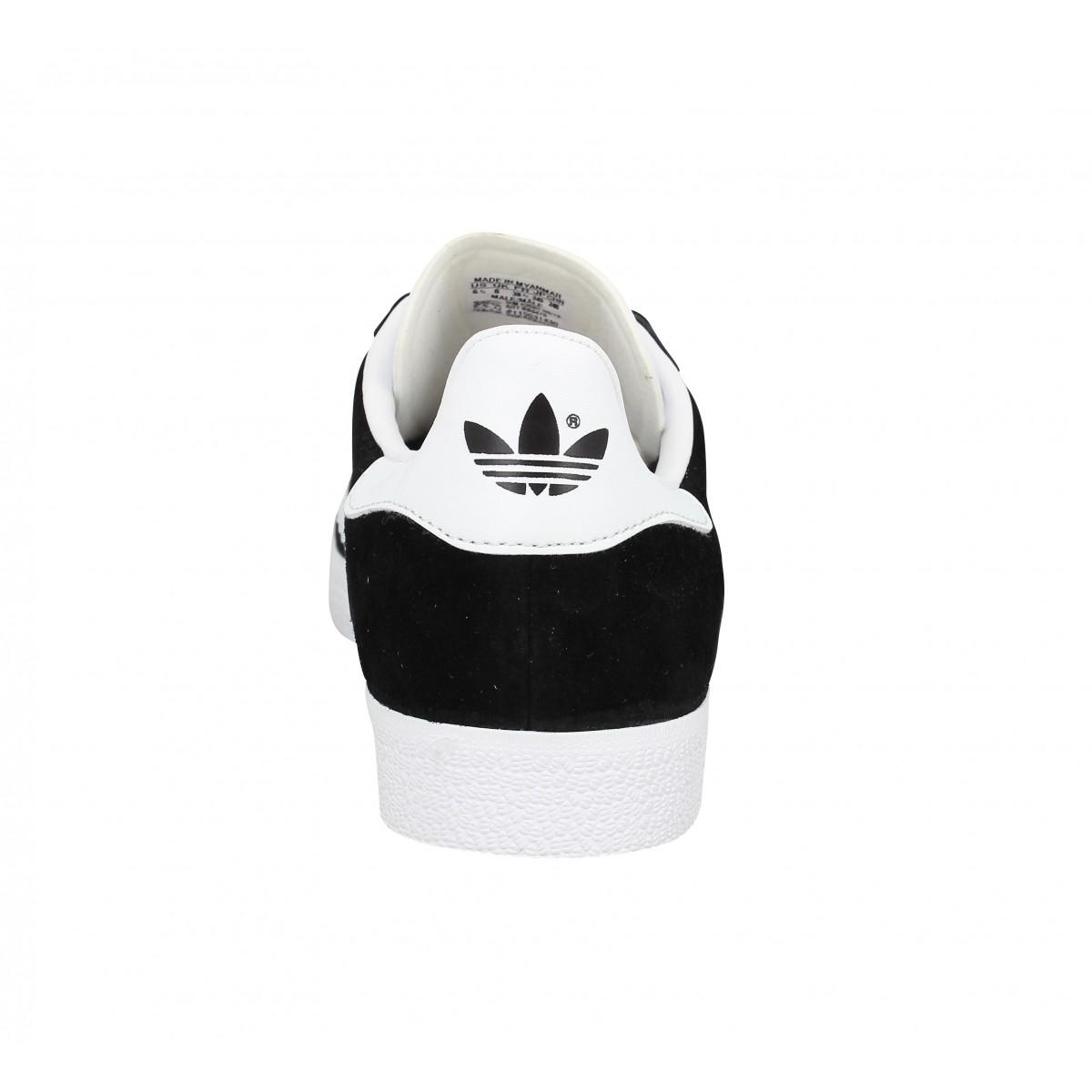 huge selection of 714da b6724 Baskets ADIDAS Gazelle velours Homme Noir + Blanc. 1